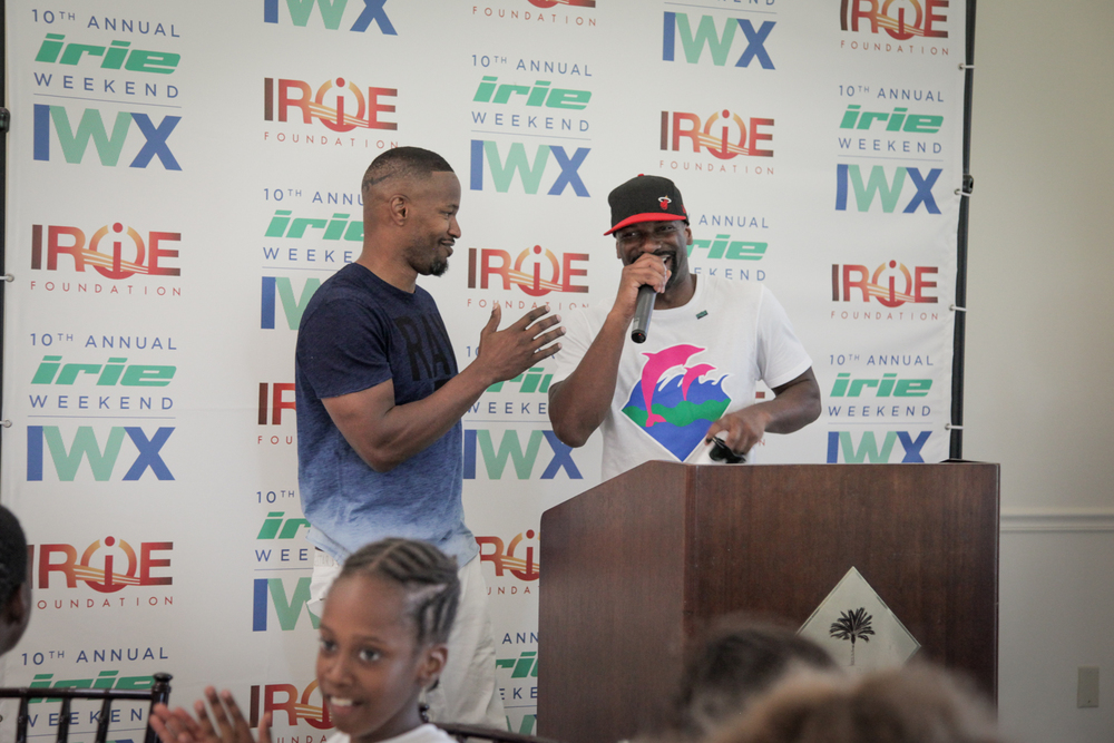 Youth Golf Clinic - Irie with mic & Jamie Step & Repeat.jpg