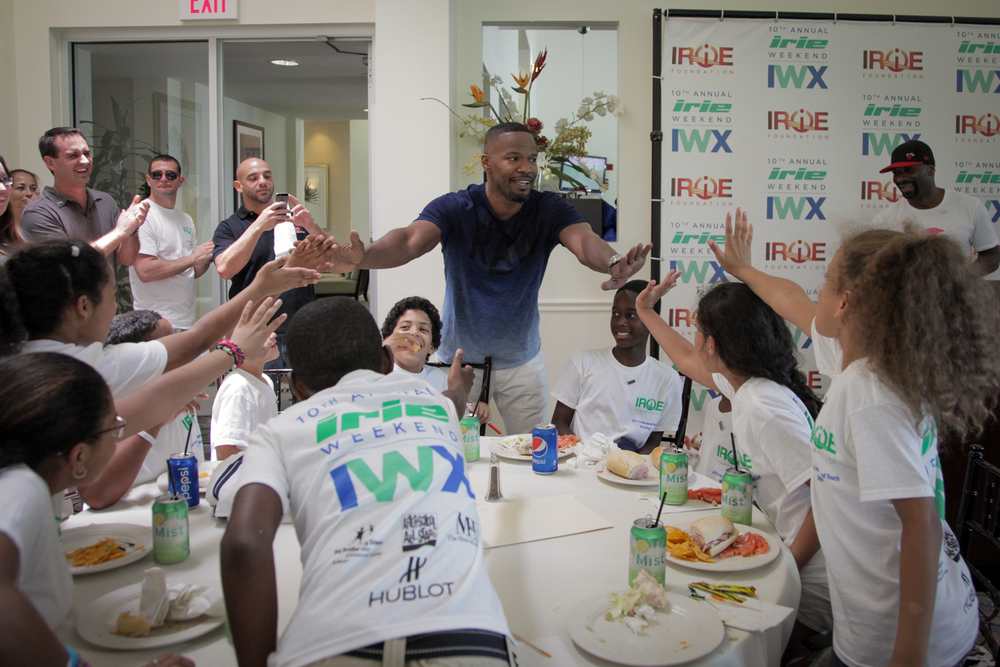 Youth Golf Clinic - Jamie Fox Reaching Out Towards Kids Irie in back.jpg