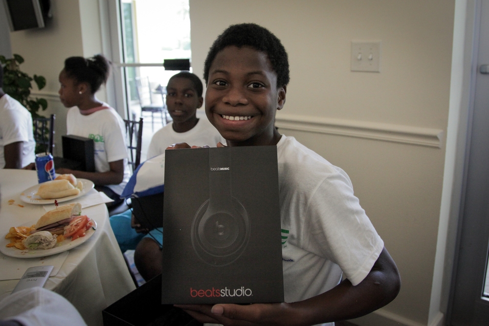 Youth Golf Clinic - Kids Smile with Beats Box better.jpg