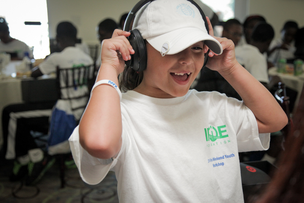 Youth Golf Clinic - Kids Smile with Beats On.jpg