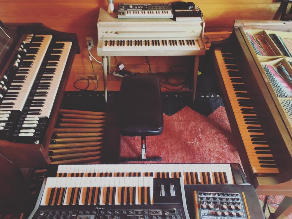 The Key Kave, clockwise, L-R:  Hammond A100  Wurlitzer 140A, Korg Microkorg  Steinway Model M  Rhodes Suitcase 73, Moog Little Phatty