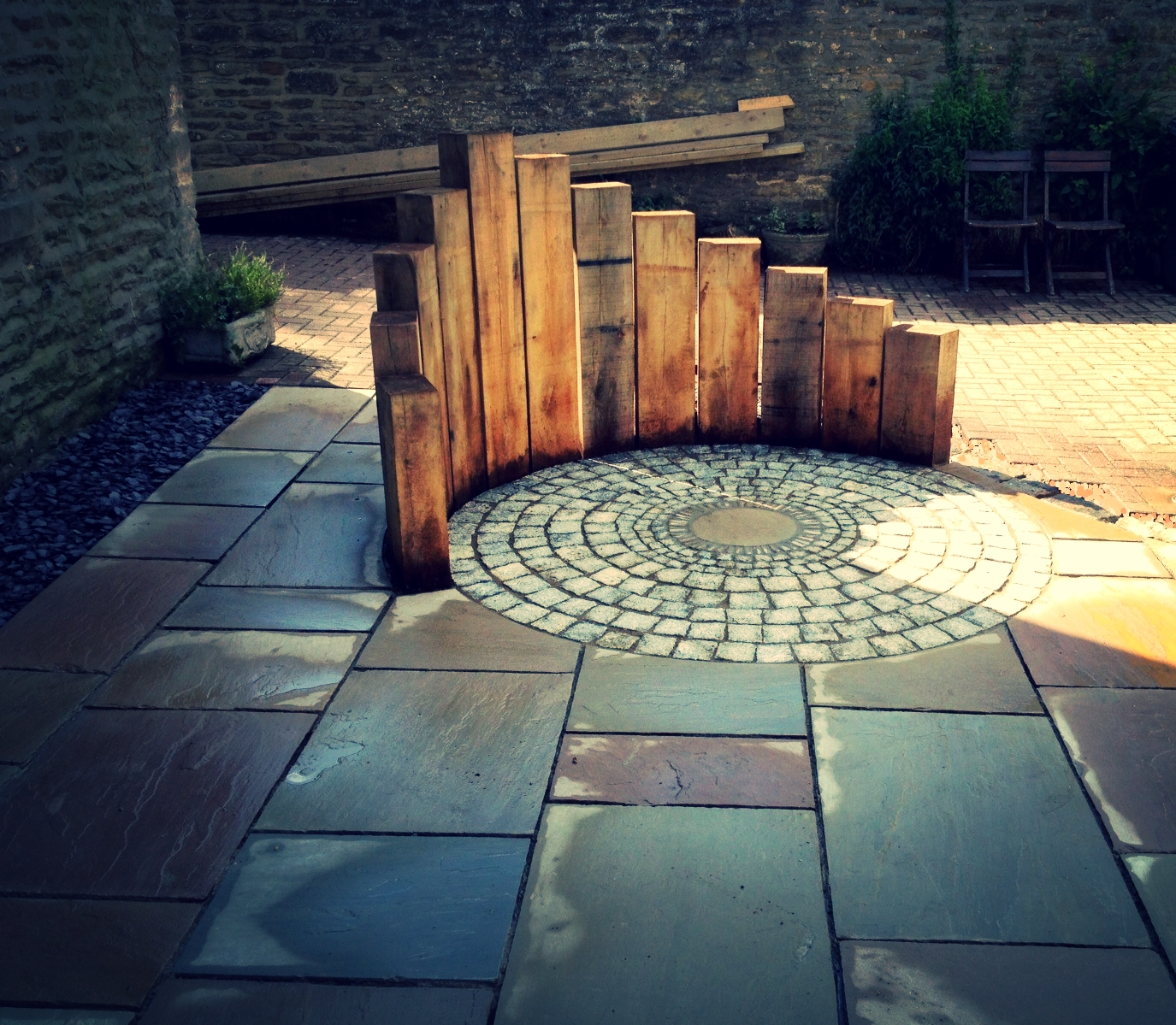 low maintenance garden design in terrington york vertical oak sleepers granite sett circle garden design