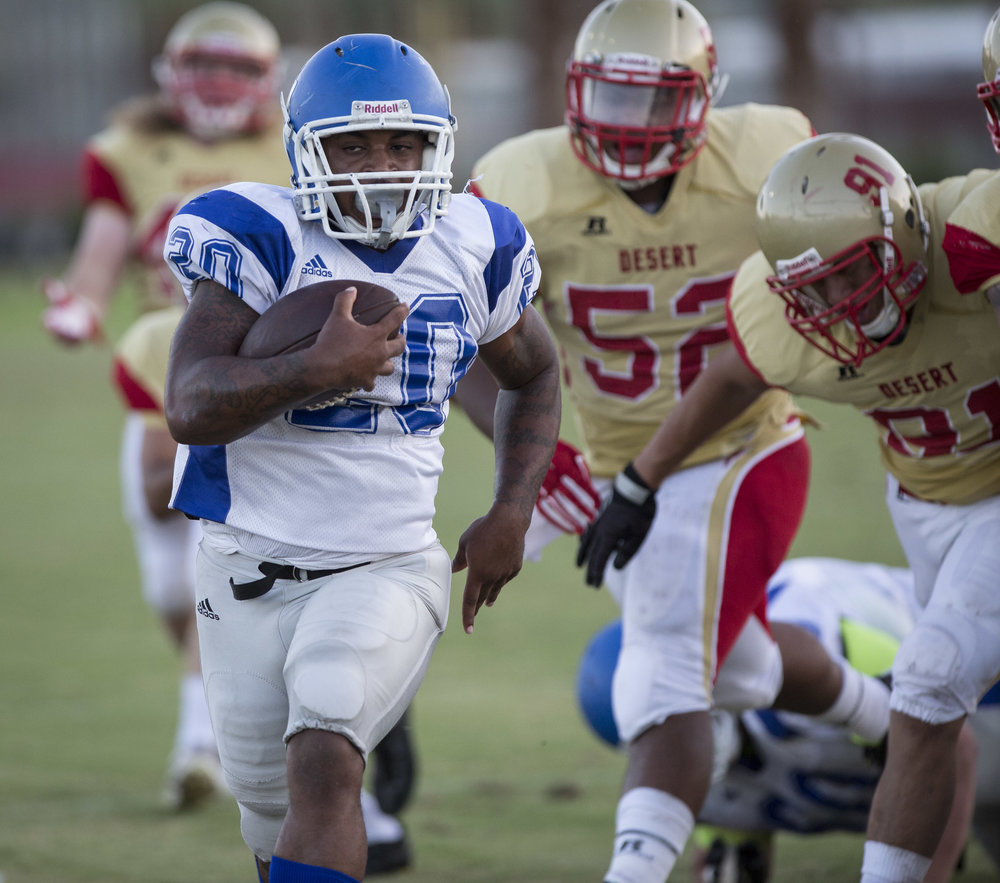 The Santa Monica College Corsairs sophmore running-back #20 Roger Jones (In White,Left) runs past defenders from the College of The Desert Roadrunners to score a 31 yard touchdown in the 2nd quarter of play. The Corsairs would win 68-25. Desert Springs, Calif., 9/5/2015 (Photo By: Daniel Bowyer/Corsair Staff)