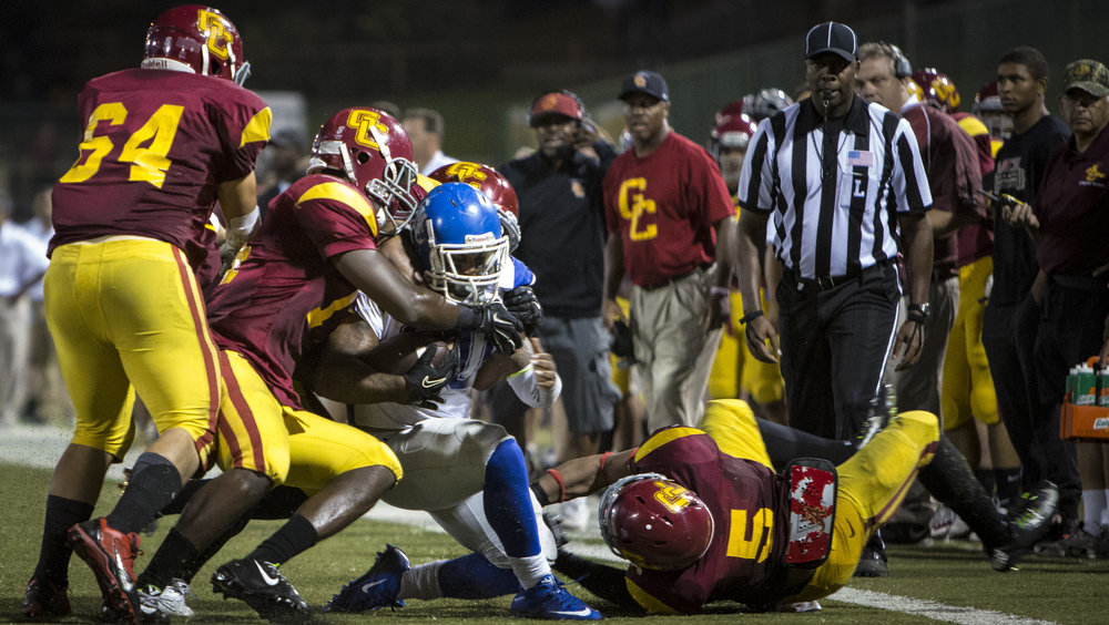 The Santa Monica College Corsairs men's football team sophmore running back #20 Rojer Jones (blue,center) ran for 22 yards on this play before this huge tackle from The Glendale College Vaquero's in an away game in Glendale, Calif. on October, 3rd 2015. The Corsairs would win 32-17. (Photo By: Daniel Bowyer/Corsair Staff)
