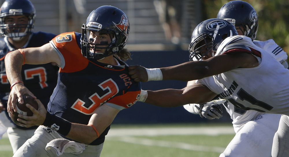 The Orange Coast College Pirates football teams sophmore quarterback (3) Kody Whitaker (left) gets sacked by The Fullerton College Hornets sophmore defensive line (91) Montre Bonner (right). The Hornets would win 35-14  away in Huntington Beach Calif., on November 6th 2016. Photo By: Daniel Bowyer / Sports Shooter Academy