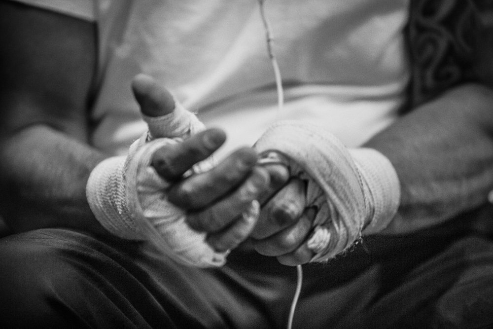 Juan Leonardo wraps his hands up beore putting on his boxing gloves, and starting his work out at the La Habra Boxing Club in La Habra Ca. on November 5th 2015. (Photo By: Daniel Bowyer/Sports Shooter Academt)