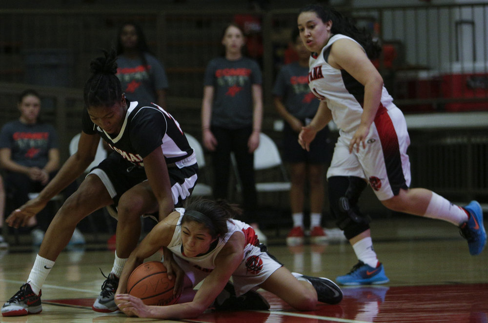The Santa Ana College Dons womens basketball team sophmore guard (21) Lauren Fruto  (right) gets losses the ball and is forced into a tangle for possession of the ball by The Palomar Comets freshman guard (21) Regina Sheffield (left). The Dons would fall to the Comets 76-61.   Photo taken October 3rd 2016 at Santa Ana College in Santa Ana Calif..         Photo By: Daniel Bowyer/Sports Shooter Academy