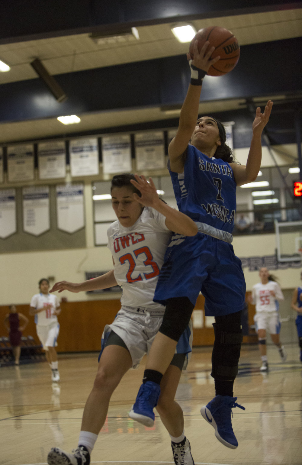 December 4th 2016. The Santa Monica College Corsair Womens Basketball team freshman guard (2) Jessica Melamed (blue,right) had an open break away but would be fouled by The Citrus College Owls freshman guard (23) Cassandra Martinez (white,left)  in the 33rd annual Lady Charger Classic basketball tournament hosted by Cypress College in Cypress, Calif.. The Corsairs would win 74-69 earning them third place in the tournament. Photo By: Daniel Bowyer/Corsair Staff