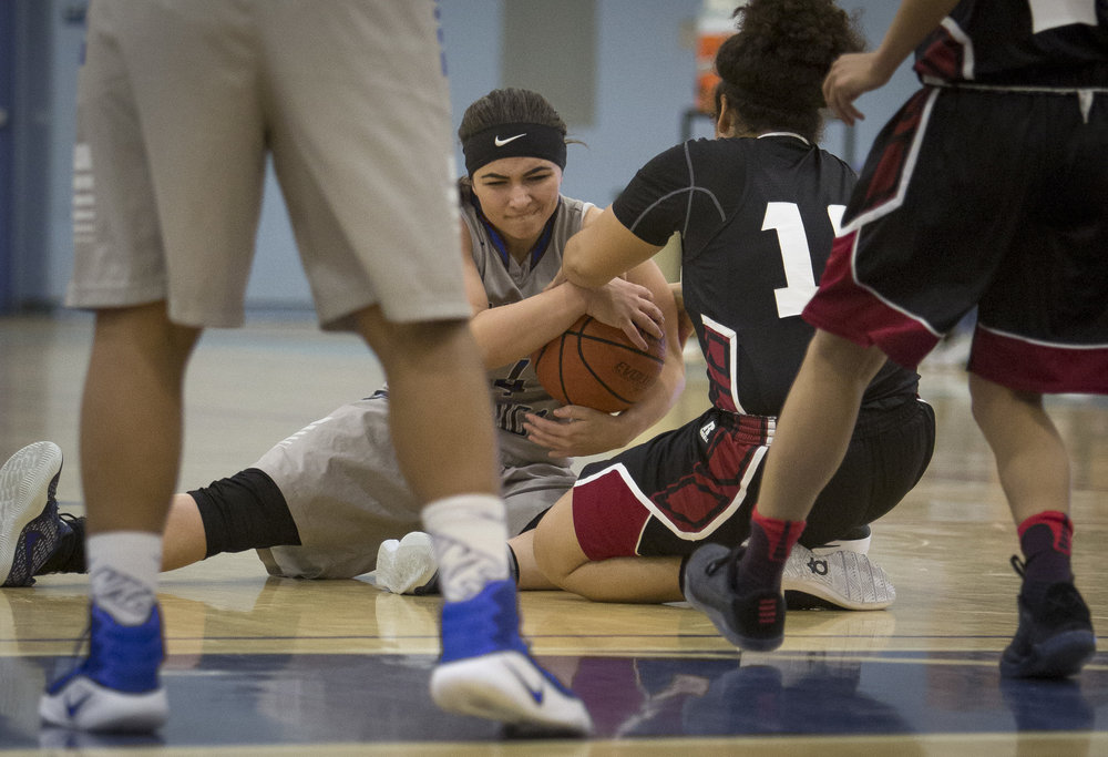 Feburary 22nd 2017 . The Santa Monica College Corsair Womens Basketball teams sophomore guard #4 Katlyn Flores (grey,left) fights for  against The San Diego City College Knight's freshman forward #12 Angeleah Johnson (black,right). The Corsairs would win at home in Santa Monica Calif. 89-78 earning them advancement into the second round of the SoCal Regional finals . Photo By: Daniel Bowyer/Corsair Staff