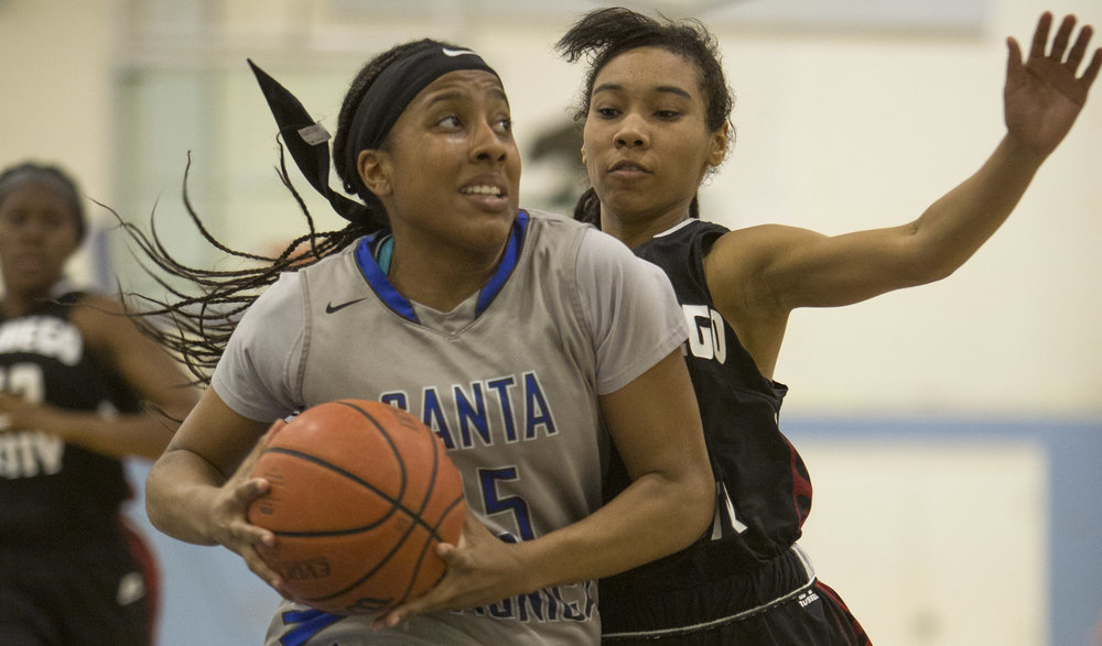 Feburary 22nd 2017 . The Santa Monica College Corsair Womens Basketball teams freshman forward (15) Lauren Davis  (grey,left) goes up for a layup to score against The San Diego City College Knight's freshman point guard #21 E'maniee Powell (black,right). The Corsairs would win at home in Santa Monica Calif. 89-78 earning them advancement into the second round of the SoCal Regional finals . Photo By: Daniel Bowyer/Corsair Staff