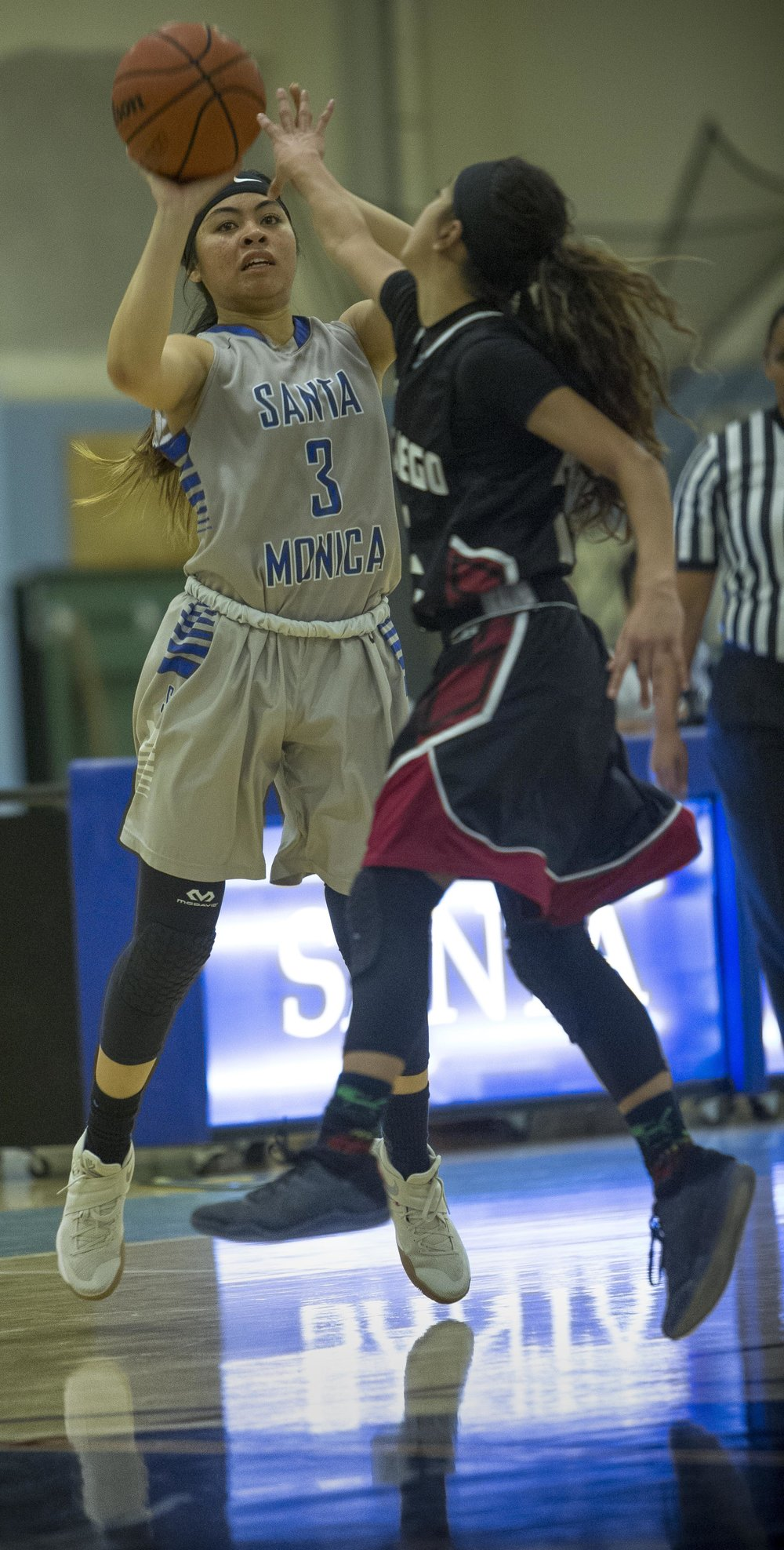 Feburary 22nd 2017 . The Santa Monica College Corsair Womens Basketball teams sophomore forward #3 Katya Echavez shots a three pointer to score against The San Diego City College Knight's sophomore guard #32 Evangeline Morga (black,right). The Corsairs would win at home in Santa Monica Calif. 89-78 earning them advancement into the second round of the SoCal Regional finals . Photo By: Daniel Bowyer/Corsair Staff