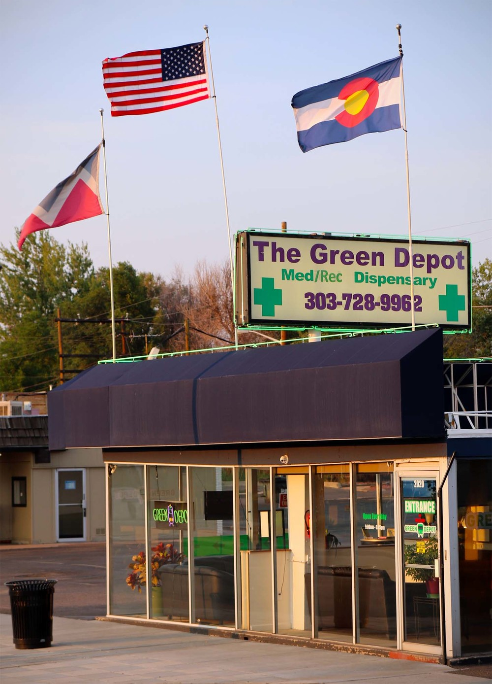 Flags fly over The Green Depot on Broadway St.