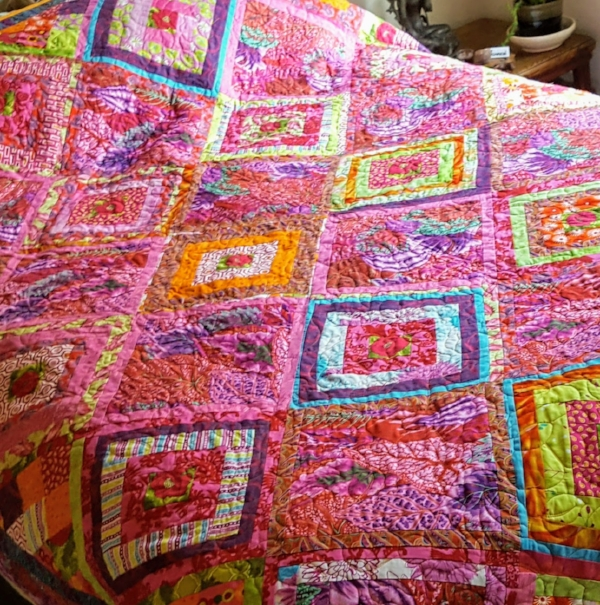 Pink and red quilt I made in 2010, finally had it quilted. I am happy everyday I wake up and see it on my bed.