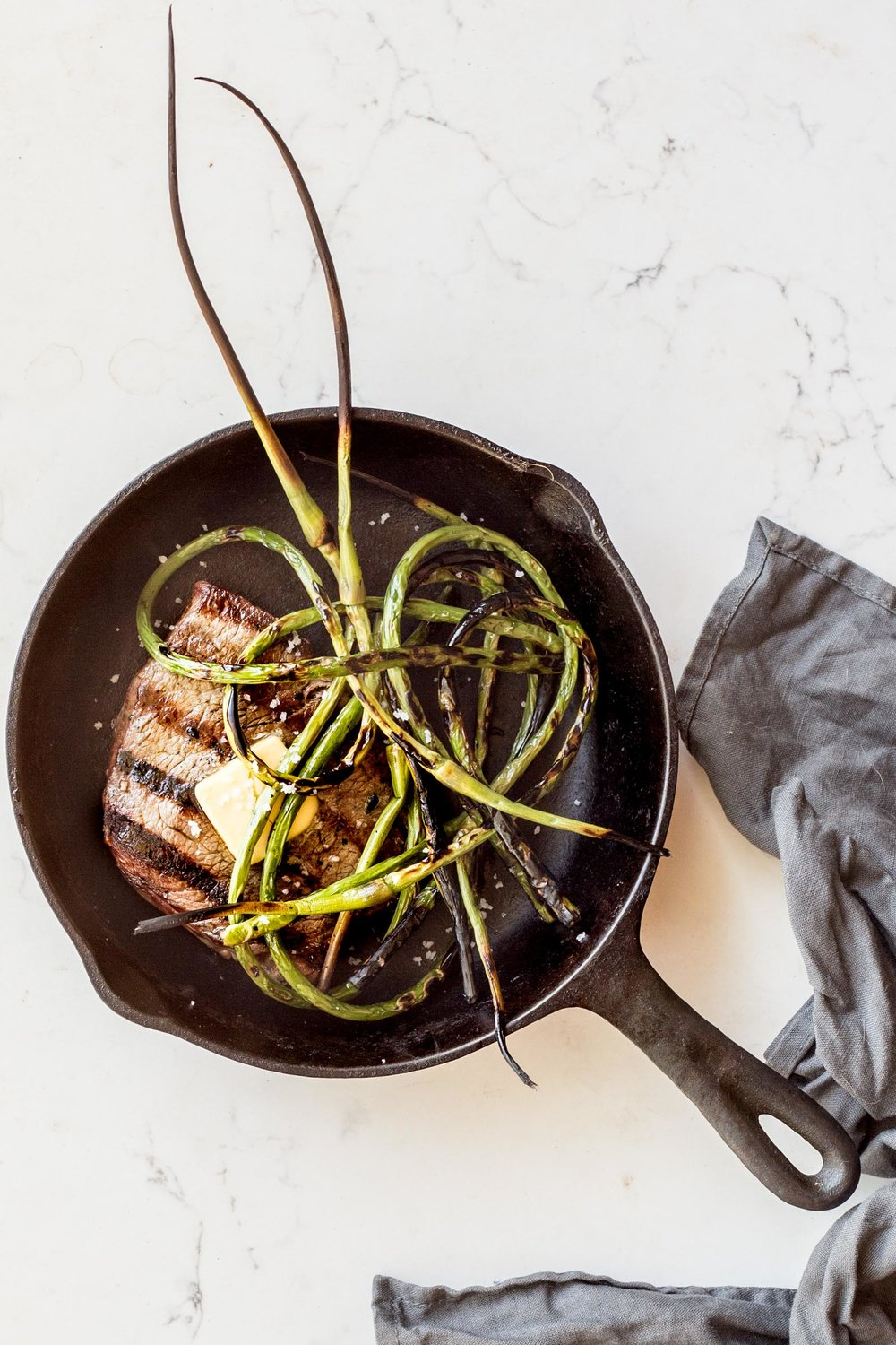 Grilled Steak with Crispy Garlic Scapes and Miso Butter