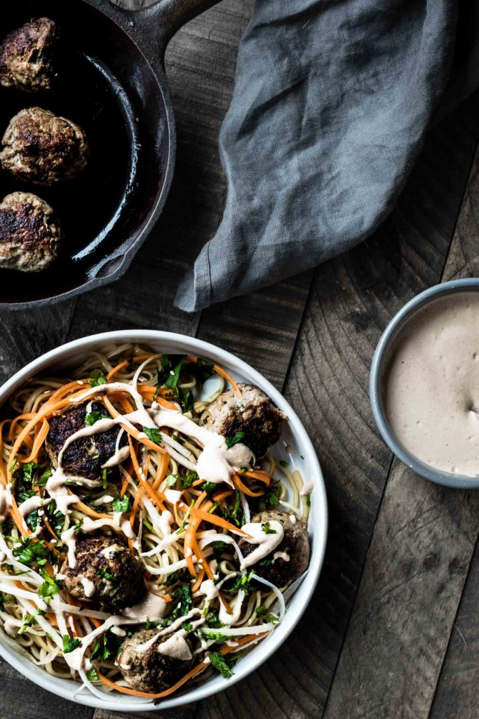 Sesame Noodle Bowls with Lemongrass Meatballs and pickled carrots and deacon