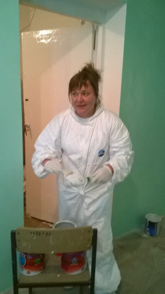 Irina (head of children's ward) painting the hospital rooms
