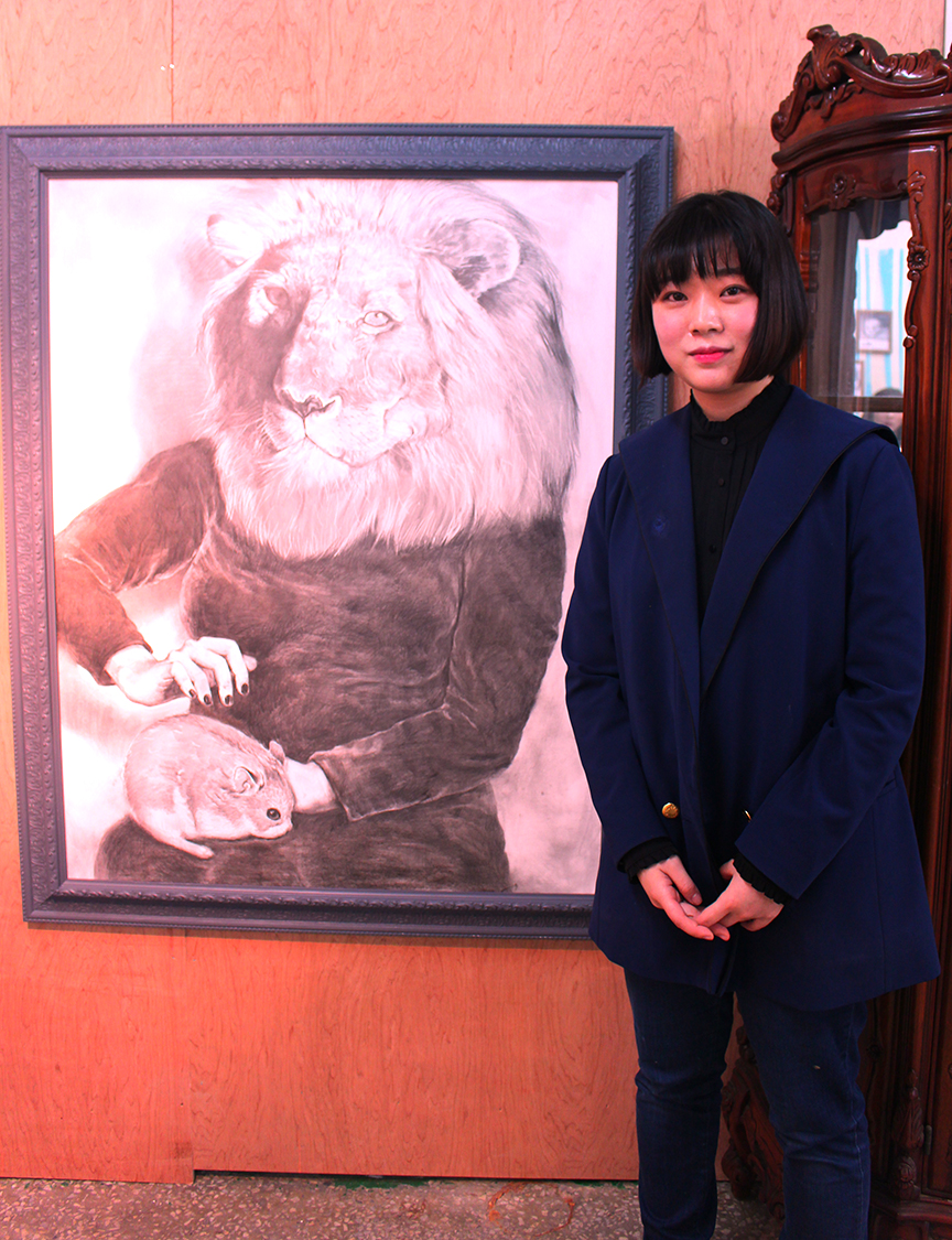 Moon Kyoung Eui next to her piece 'Darknessa' pencil on paper 2015