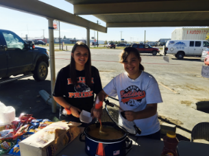 Attending a tailgate fundraiser for community after school