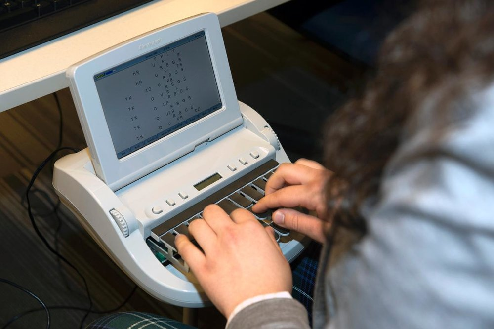 Student practicing on a stenotype machine via Daily News