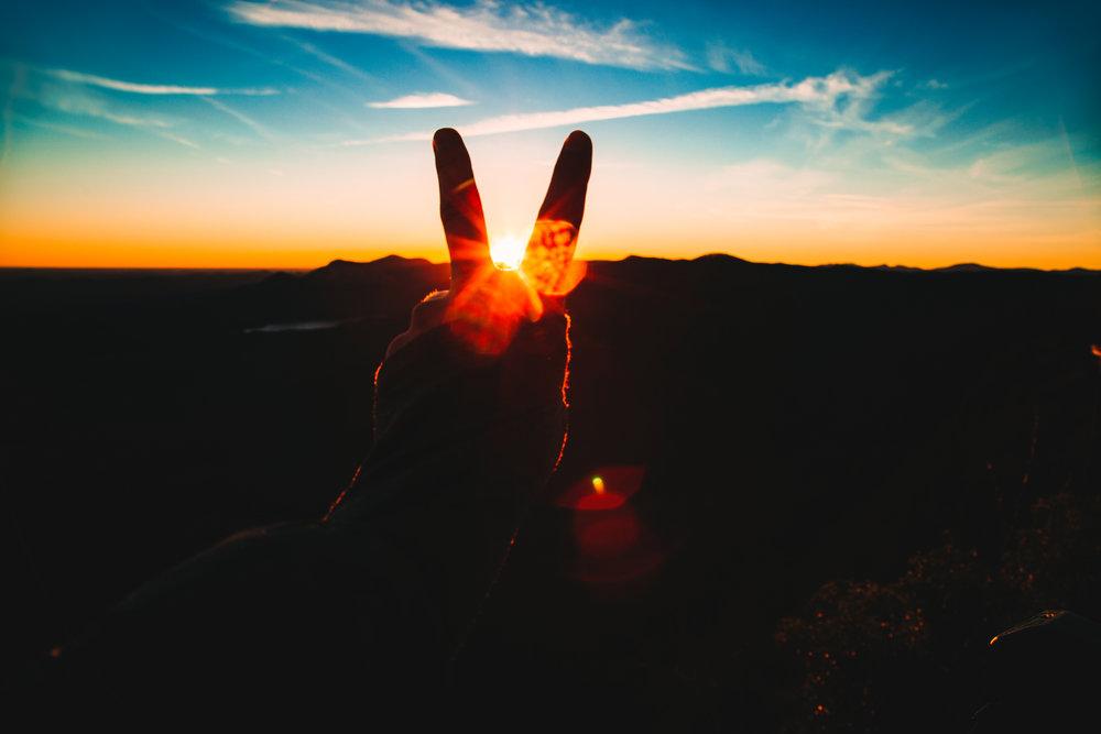 peace-sign-silhouette-sunrise
