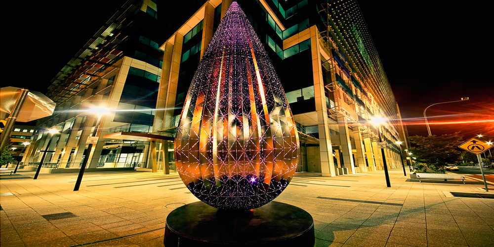 Droplet   is a major public artwork for Canberra and was commissioned for a busy street corner in the town centre of Woden in ACT. Droplet acts as both a day time and a night time beacon for the site which is inhabited by thousands of office workers and city users.