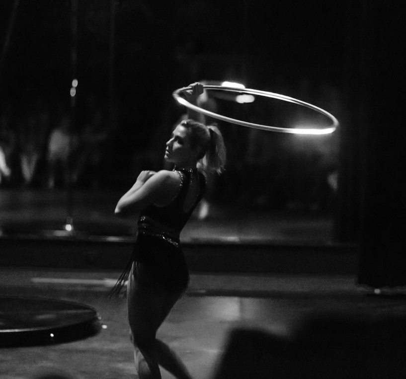 Hooping - Artists manipulate lightweight plastic hoops into a dance flow on the ground.