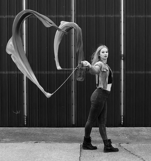 Veil Poi - Artists manipulate a weighted ball connected to the hand by lightweight chains or ropes. For veil poi, long silks are attached to each weight to create a fanned effect where the fabric chases the movement of theball.