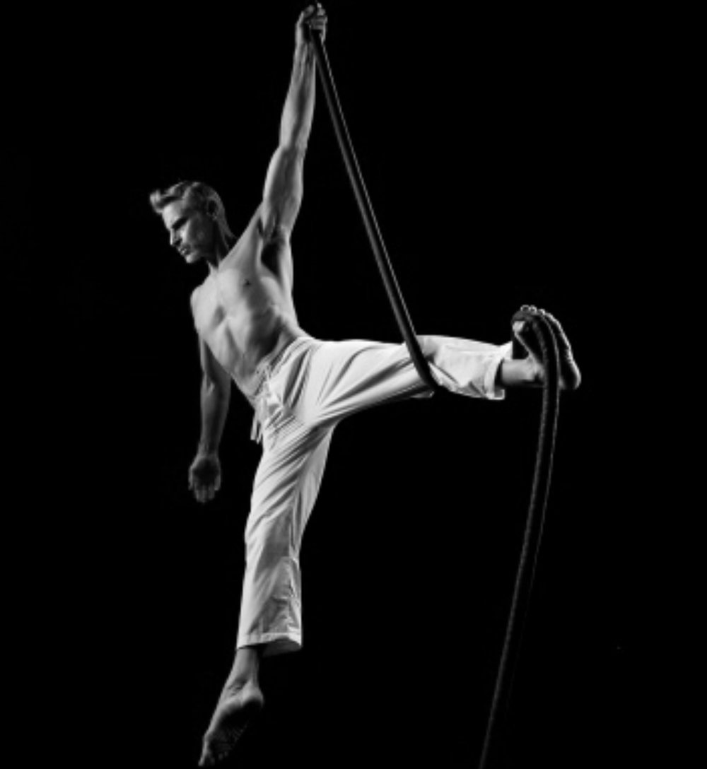 Aerial Rope - A vertical apparatus featuring one long rope. Like aerial silks, artists climb and wrap, but due to its minimalist nature, rope highlights strength moves and dynamic swings.