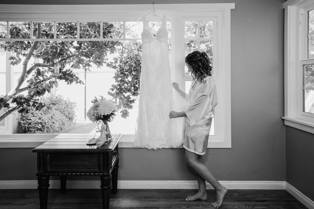 She takes a look over her dress...looking forward the day ahead!