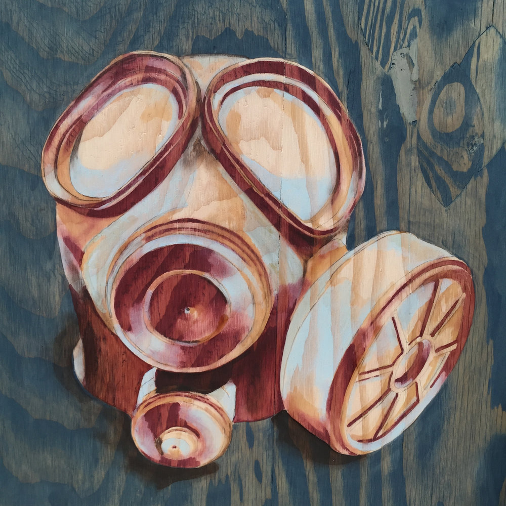 "Gas Mask III                               16""   x 16""                               wood stain on   plywood"