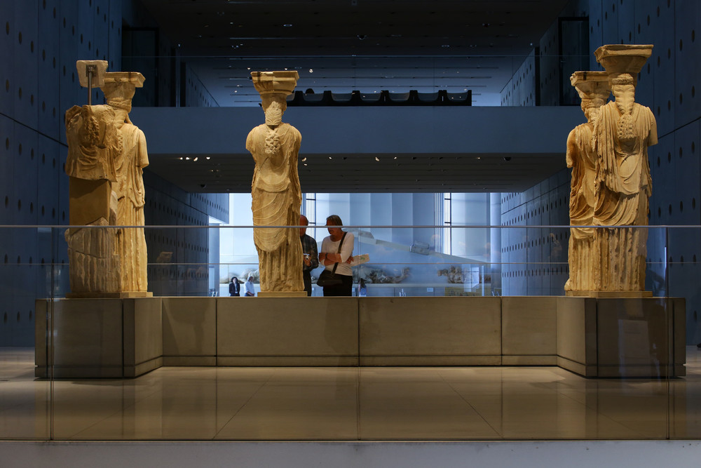 The infamous Caryatides housed in the Acropolis Museum (Picture by Michel Simeonidis)