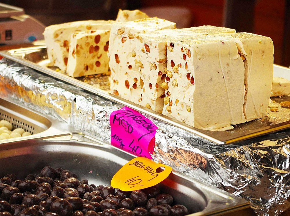 Tahini based Greek halva with nuts is one of the top delicacies in the Greek food hall of fame!