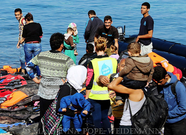 Refugees welcomed and assisted in the island of Lesvos (Picture by Marienna Pope-Weidemann / Flickr)