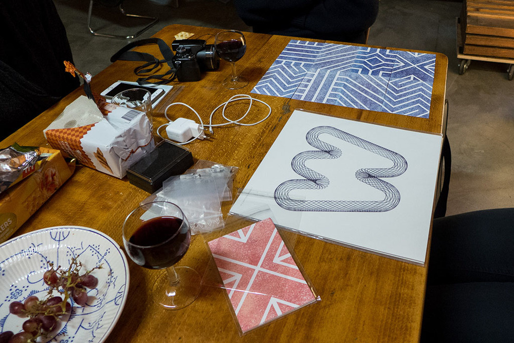 Snacks, wine and Leonie's work. Photo by Rolf Rosing