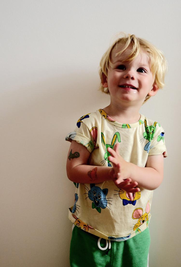 Austin wears  Ducky Street  tattoos,  Mini Rodini  t-shirt and H&M track pants (similar  here )