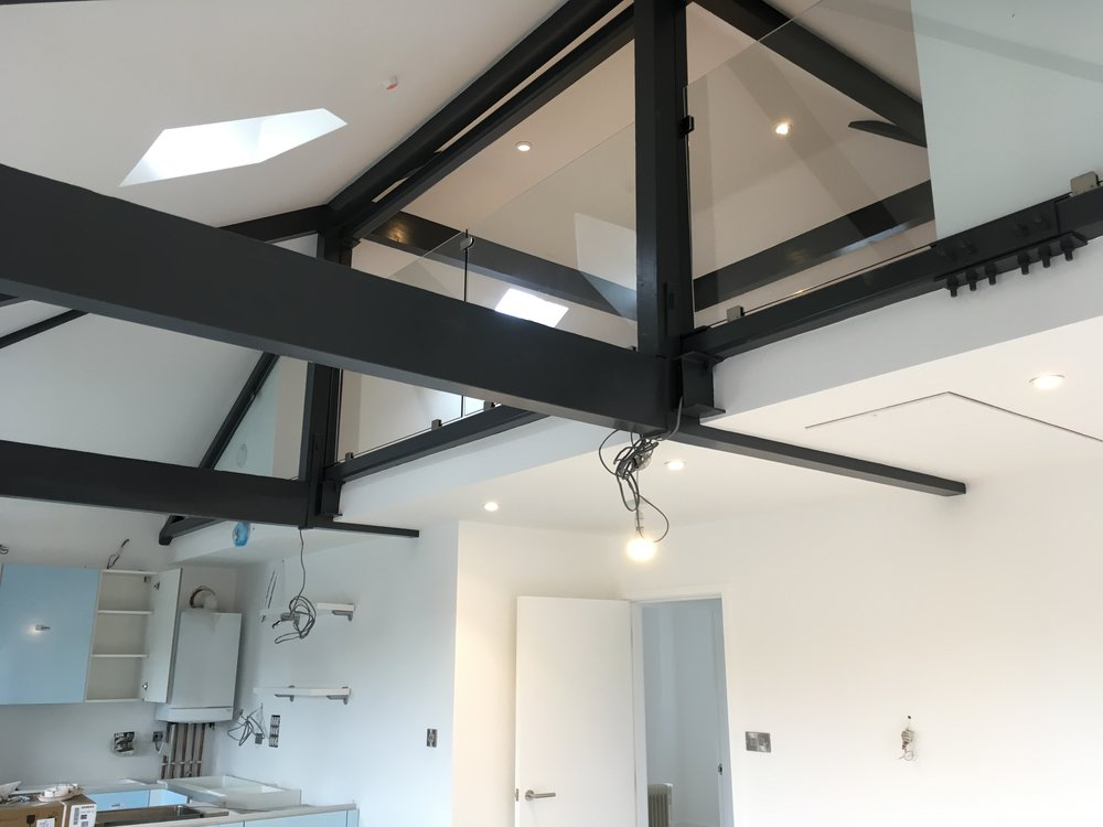 Top floor flat living area with mezzanine above