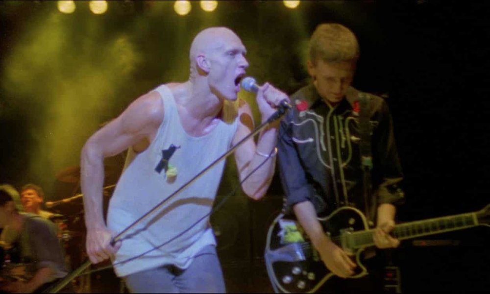 It was October 1984 and  Peter Garrett , the frontman for Midnight Oil, should have been riding high. The band's fifth album, Red Sails in the Sunset, had just topped the Australian charts – the band's first number one.  Instead, he was restless and preoccupied. In his memoir, Big Blue Sky, he admitted he hadn't contributed much by way of music to the album, recorded in Tokyo.  When it was complete, he and his partner Doris visited Hiroshima.