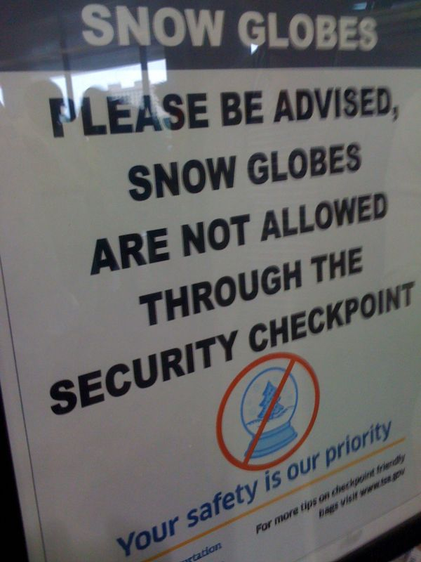 The maniacal terrorist snow globe signs were ALL OVER Delta LGA.