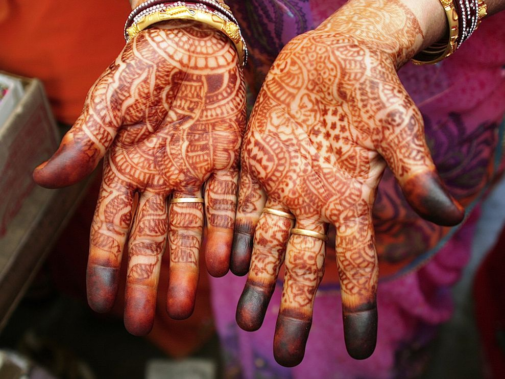 iindia :      jmsc :     June 10, 2010   Henna Hands, India   Photograph by Petra Warner, My Shot   This Month in Photo of the Day: Travel   The hands of a woman in Jaipur are covered with mehndi patterns painted with henna. Trendy in recent years, the lacework decorations are part of a 5,000-year-old tradition of creating designs to ward off evil or declare one's happiness