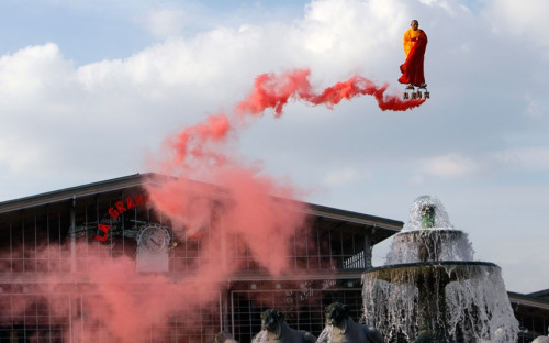 Chinese artist Li Wei performs in the sky over the Fontaine of Lyons at La Villette in Paris. Li Wei's work often depicts him in apparently gravity-defying situations. via ryandonato: