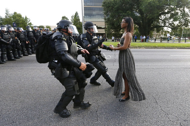 A woman stands in protest in Baton Rouge, photo by Jonathan Bachman