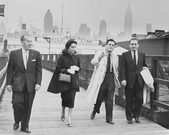 1957: Art Cohn, Elizabeth Taylor, Michael Todd and a fourth unidentified man stroll the gangway, October 18, 1957.