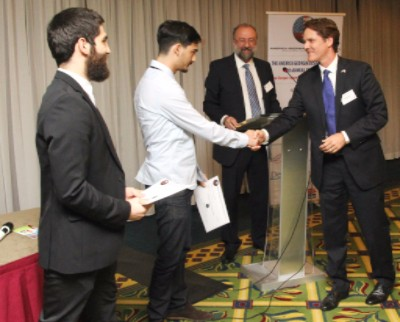 Robert Powell, Chief Legal Officer of Georgian American Alloys (GAA) presents the second place prize to Nebula Ltd.