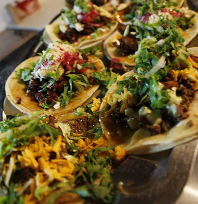 Cold, snowy #Saturday calls for #Tacos. Trays on trays on trays. Open now for dinner! #Toronto