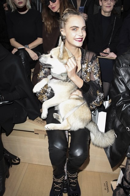 Cara Delevigne front row with her dog, Leo