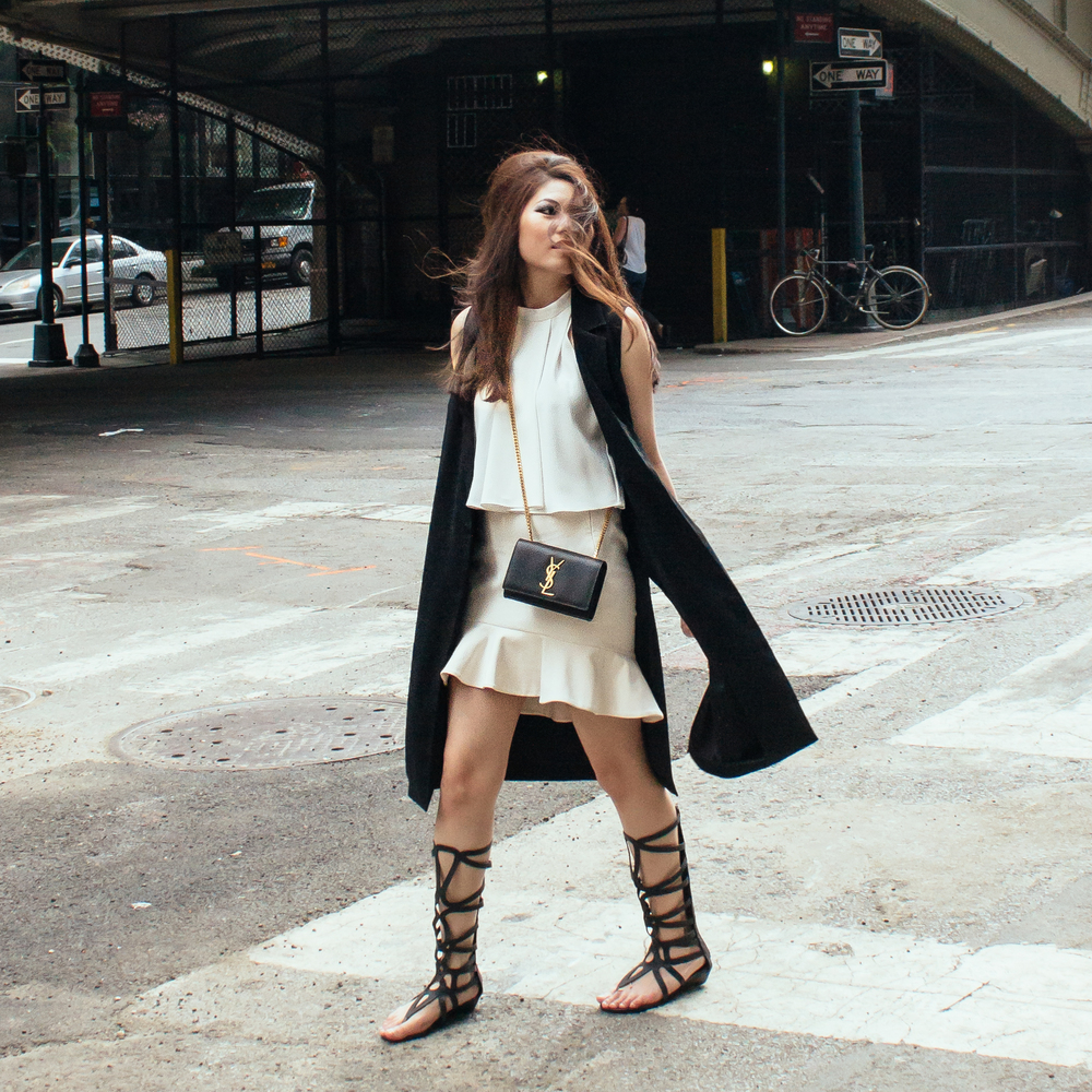 Saint Laurent Paris Crossbody Bag ( here ), Topshop Sleeveless Coat ( here ), Gladiator Sandals ( similar here )