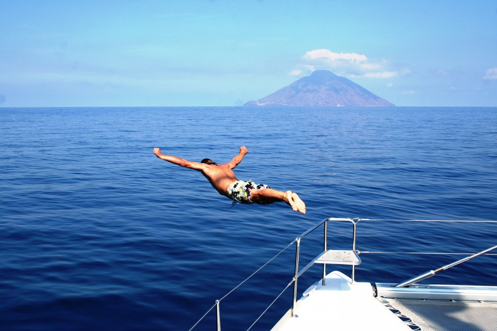 DIVING OFF BOW IN FRONT OF STROMBOLI.JPG