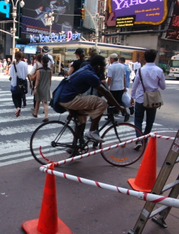 An NYC biker takes advantage of the Times Square bike lanes