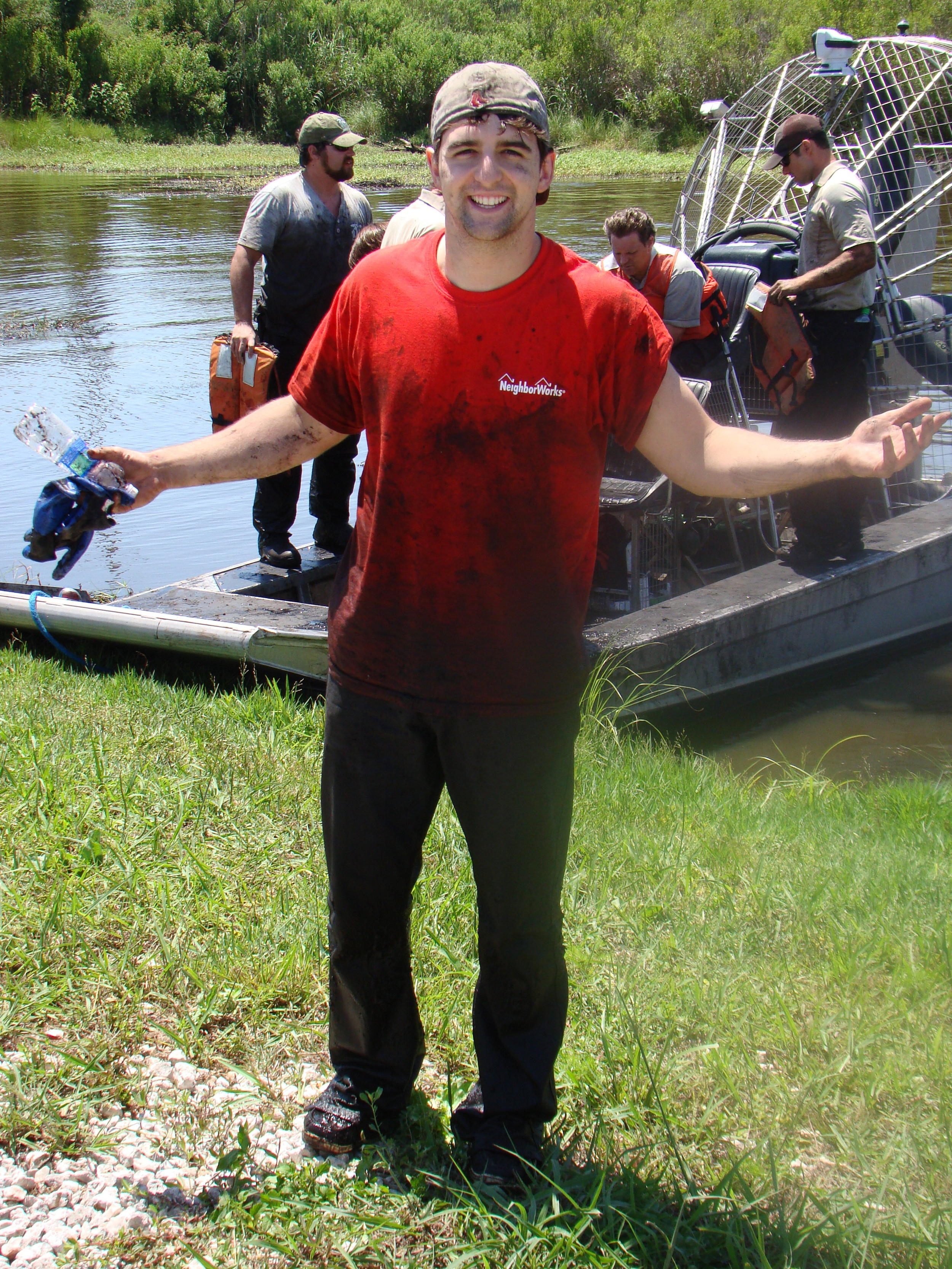 Covered in bayou mud, Global Green's Patrick Orr poses for the camera.