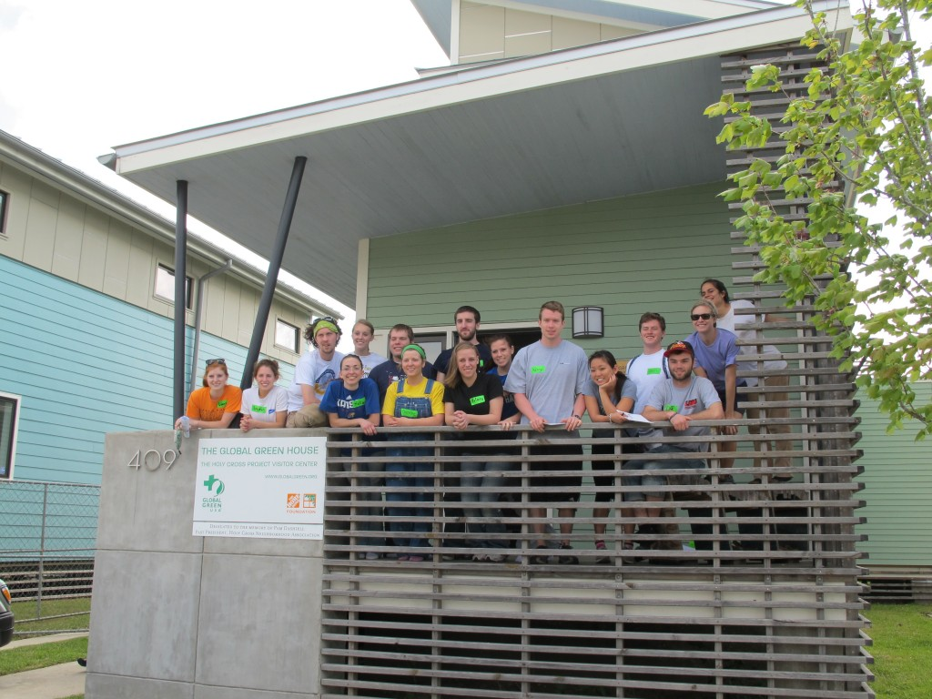 Historic Green volunteers pose outside the Holy Cross Project after their tour